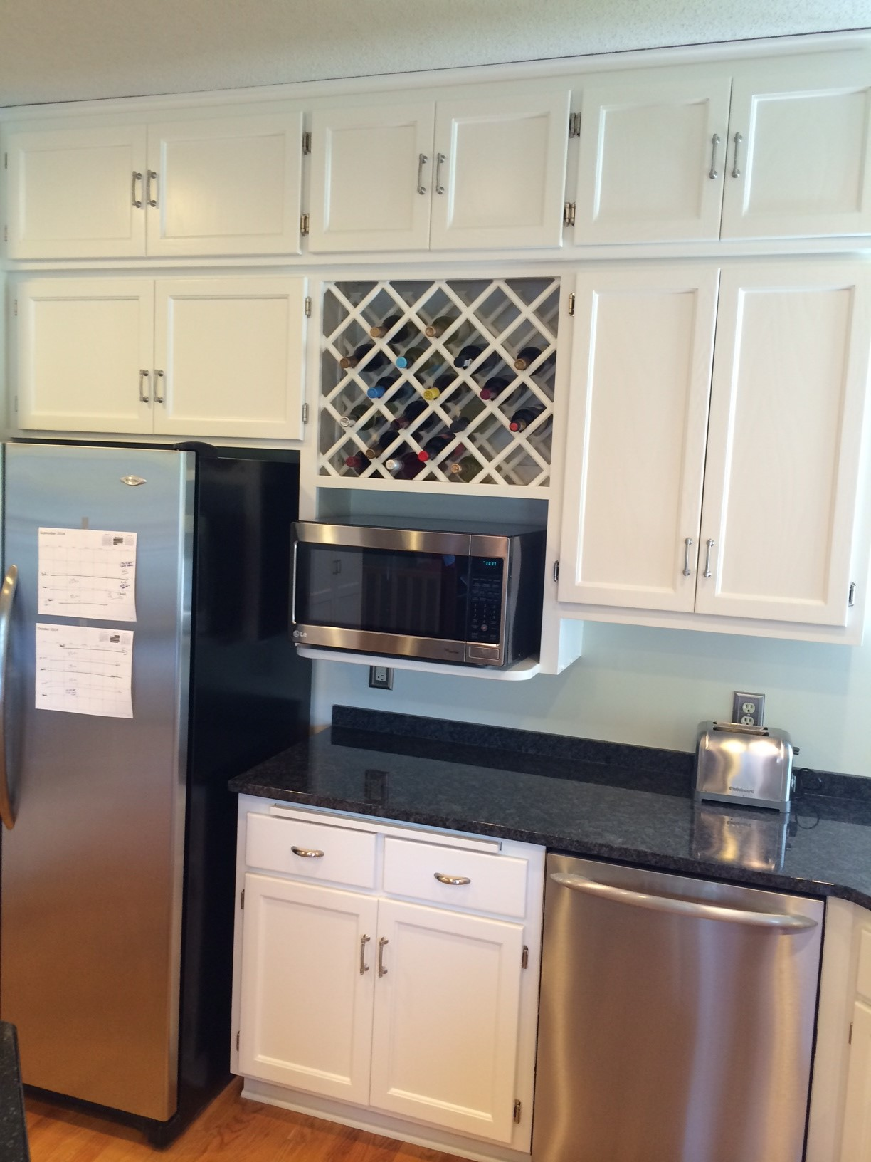 installing kitchen cabinets wine racks and more painterati 1888
