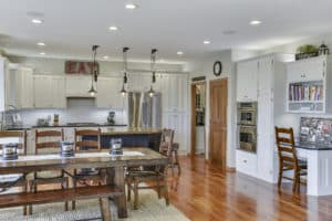 Minneapolis, Interior Painters, House Painters, Best Painters, Painting Contractor, Cabinet Painting, Cabinet Refinishing, Kitchen Cabinet Refinishing, Black island with rub-through specialty finish and cherry kitchen perimeter cabinets now enameled white.